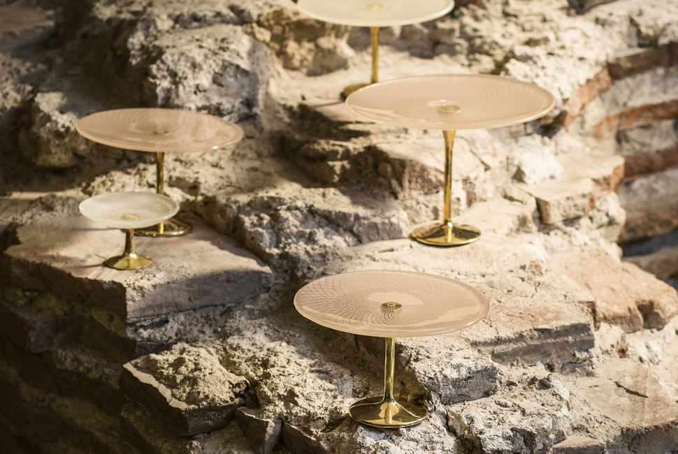 Patterned cake stands on bronze pedestals by AnnaVasily posed on top of ancient ruins.