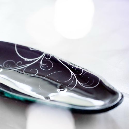 Close-up of tableware designer Anna's blue salad plate with pattern, made from glass.