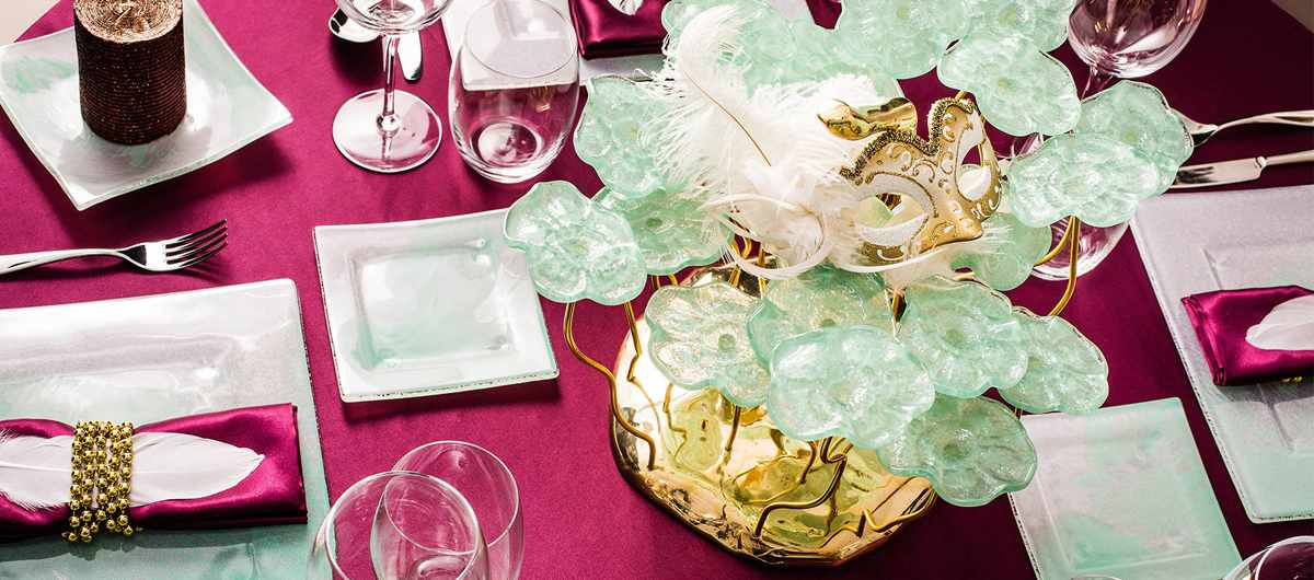 Square side plate Ruby on a green, gold and purple festive table setting with luxury tableware for Mardi Gras.