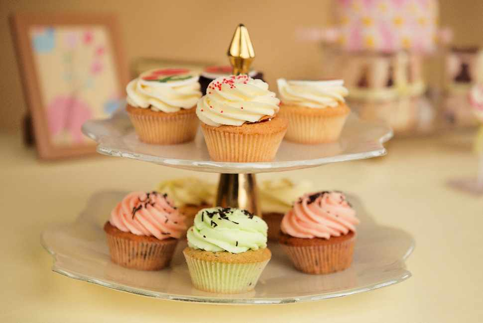 Stylish candy buffet high tea stand Truffle in beige and light blue by Anna Vasily with colourful cupcakes.