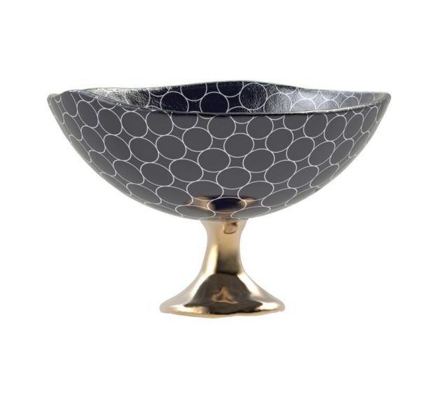 Blue fruit bowl on pedestal