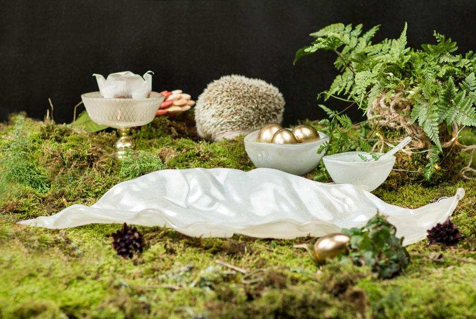 Easter egg basket leaf shaped platter Zahra is a leaf shaped fruit platter in cream with light dawn blue highlights. Zahra is in between a forest environment with hedgehog and classy Easter decoration, cupcakes and golden Easter eggs