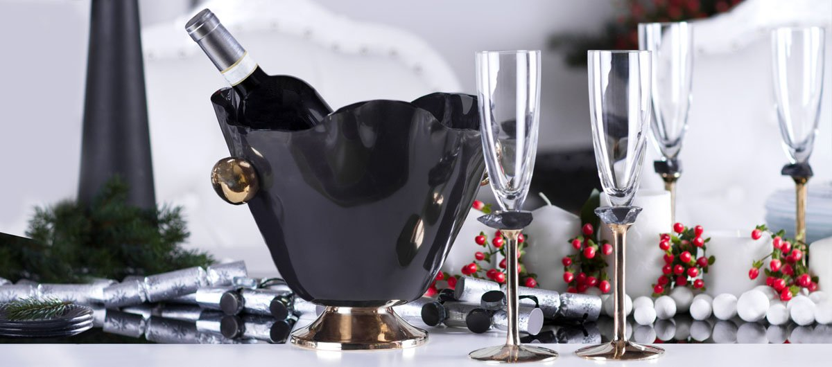 Blue table setting - blue wine ice bucket with a bronze pedestal and handles with beautiful glasses on a bronze pedestal and napkin holders in complimentary colours