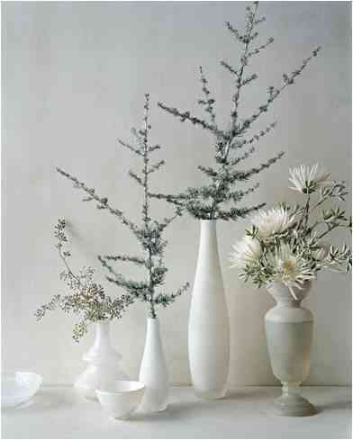 Wintery Natural Elements white vases with lovely branches of pine and other winter trees