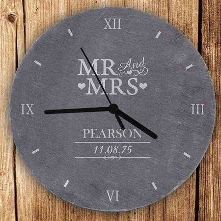 Customized watch for the wall in stone grey on a wooden wall