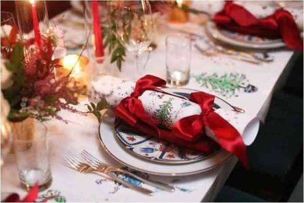 Ribbon Tied Napkins in Christmas table setting