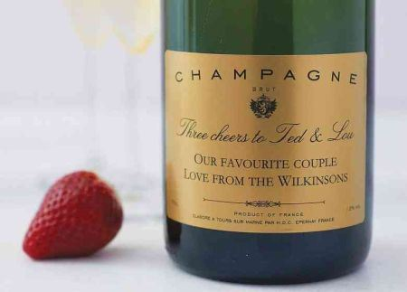 Customized champagne bottle with the names of the couple getting married