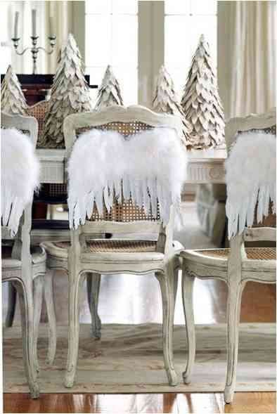 Beautiful angel wings as accessory to the back of a chair for Christmas lunch