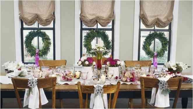 Christmas lunch table setting with fresh flowers