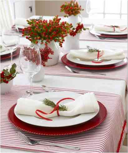 Table setting for Christmas with minimalistic red elements
