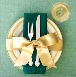 Green Christmas table setting with gold accents