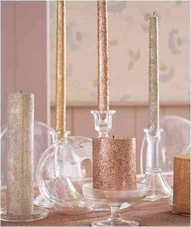 Glittery candles with different hights used to enlighten the Christmas spirit