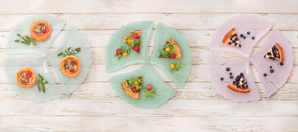9 triangle pizza plates in blue, green and pink arranged in 3 circles like a pizza with different gourmet pizza slices.