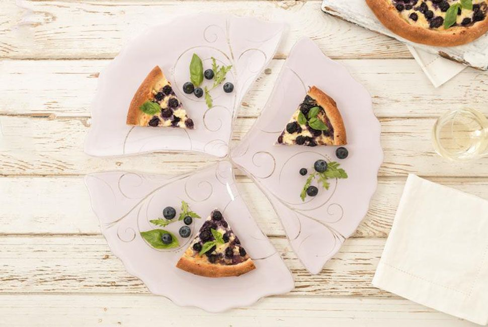 3 triangle pizza pplates arranged in a pic with blueberry pizza slices.