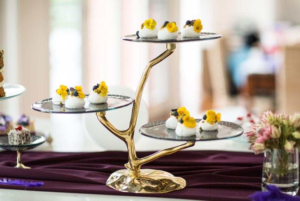 Fairytale modern 3 tier glass cake stand with a bronze stand in the shape of a twisting tree branch.