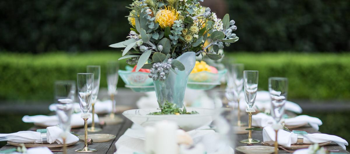 Elegant table setting for Australia Day garden party with mint green and gold dinnerware and decoration.