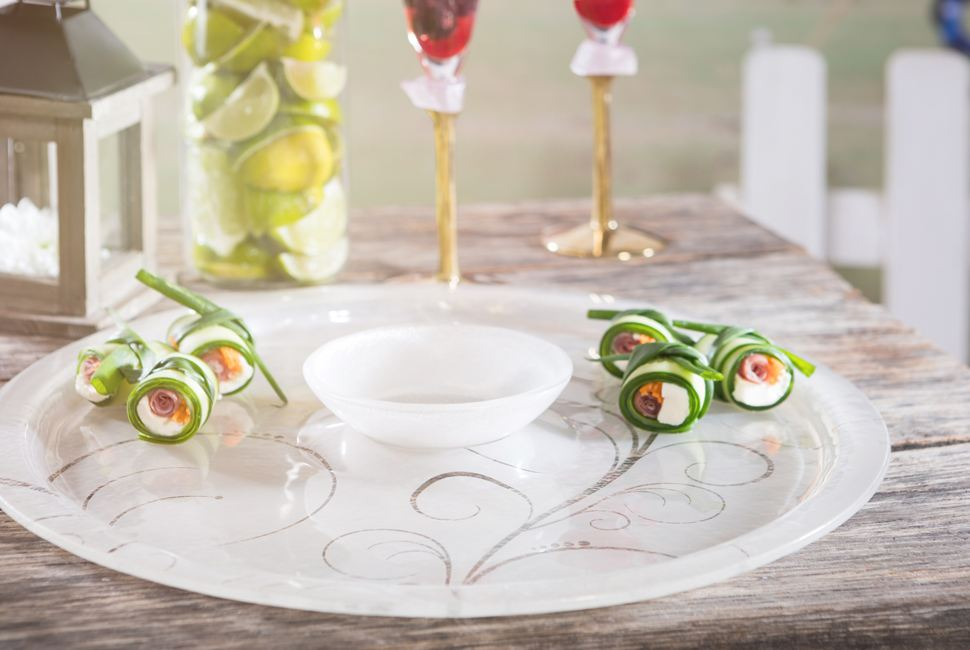 Heme is round serving dip platter teamed with a small bowl, both in gentle cream with our lively Vivace pattern.