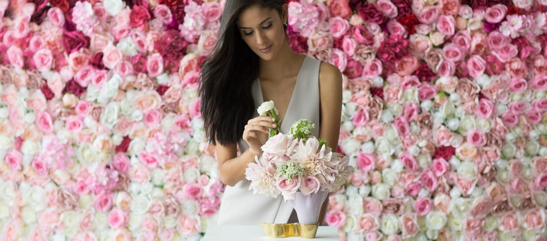 Pastel pink plates by annaVasily - A woman arranging a bouquet in a beautiful pink vase