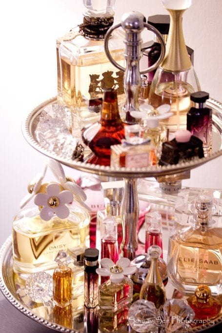 2 tier cake stand covered in perfumes