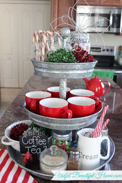 3 tier cake stand made of metal covered in cups, straws essential intermediates for hot chocolate