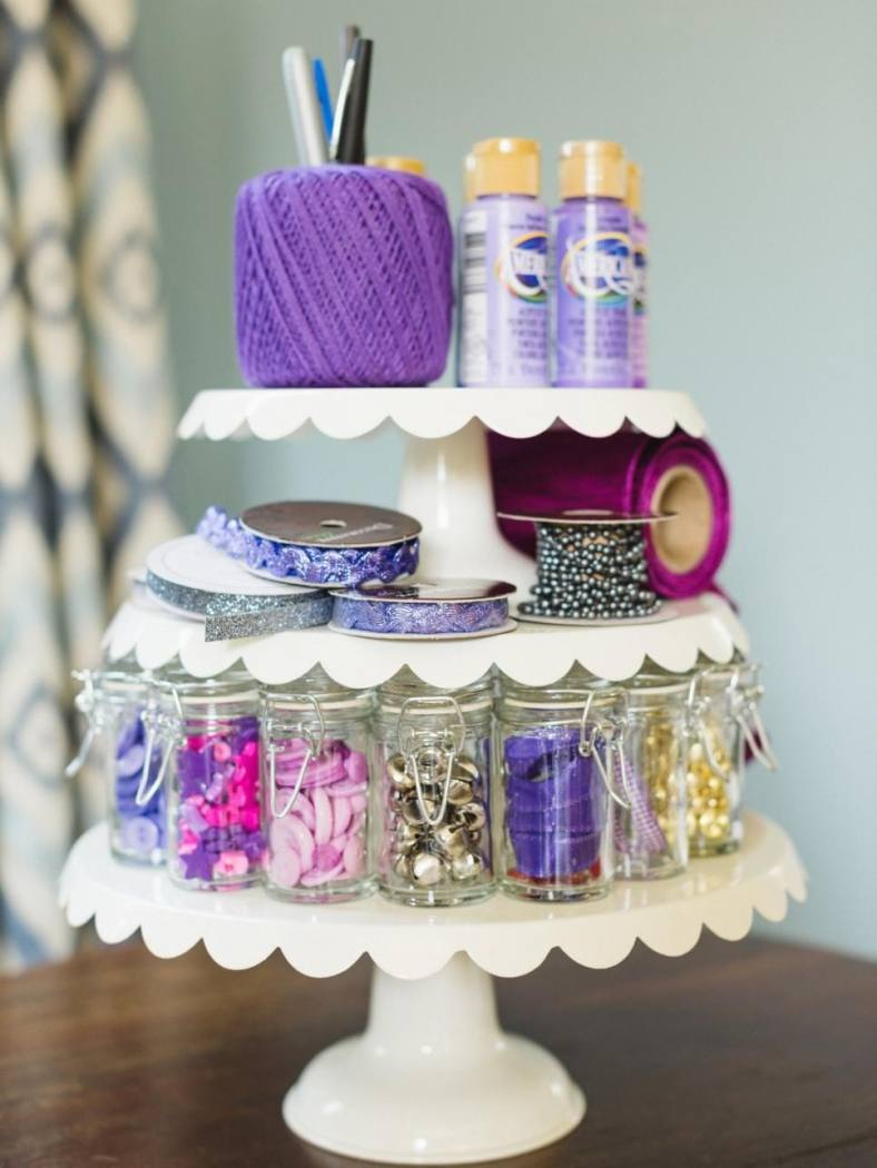 3 tier cake stand covered in wool, jars or glitter and other arts and crafts materials