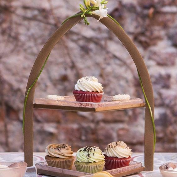 2 tier cake stand covered with cupcakes
