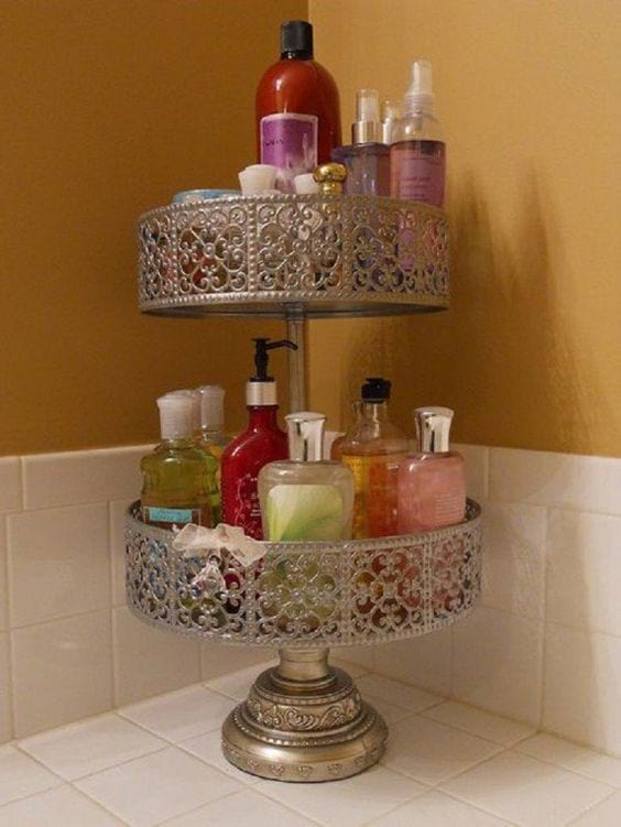 2 tier cake stand covered in lotions, shampoos and other cosmetics