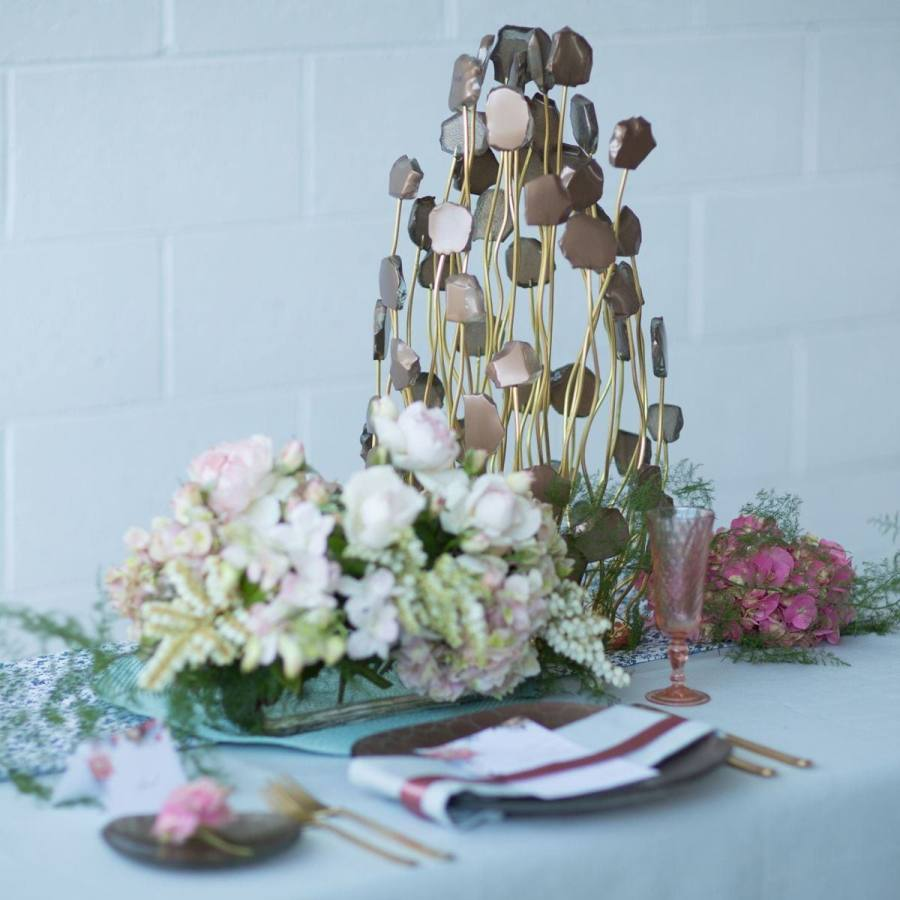 wedding ideas - unique centrepiece on table setting with deisgner tableware and pastel flowers