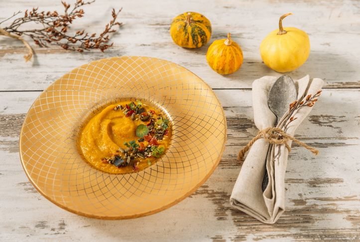 gold dinner plates - amur soup bowl with a butter nut squash soup