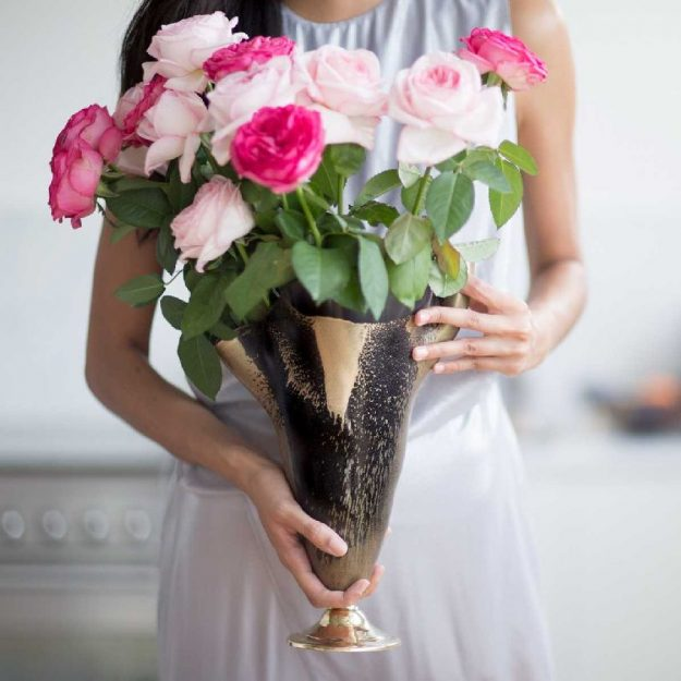 Navy Blue Flower Vase Centrepiece with Gold Highlights Cynthi with Roses Held by Woman - Anna Vasily