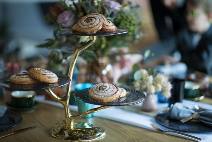 Stylish Father's day tablescapes with a 3 tier cake stand with a bronze pedestal with cinnamon rolls.