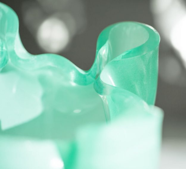 Closeup of Mint Green Organic Glass Flower Vase Design On Brass Base Paris by Anna Vasily