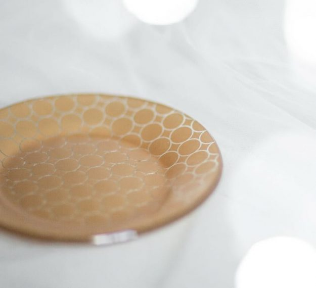 Gold side plates, Dune set/6 round glass side plates with modern design by Anna Vasily on white.