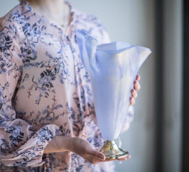 Modern violet vase on pedestal