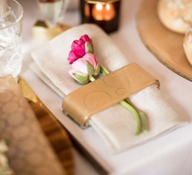 Elegant gold napkin holder with a rose, Zin set of 6 matte gold napkin rings by Anna Vasily.
