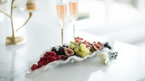 Decorative glass bowls as a centerpiece with grapes by Anna Vasily.