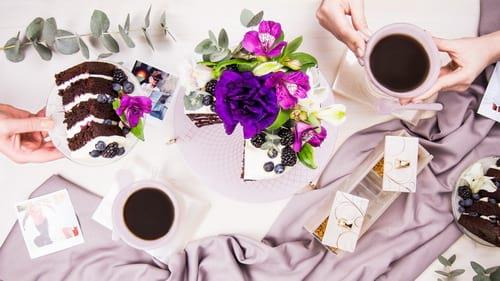 Luxury high tea set featuring a glass sugar box, glass tea cups and high tea spoons by Anna Vasily.