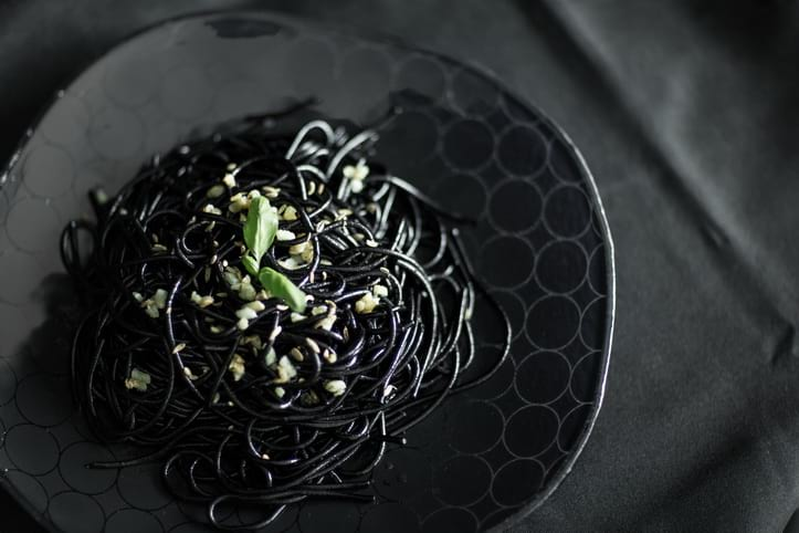 Halloween Dinner Party tablescapes with the blue black designer dinner plates Magda with squid ink pasta.