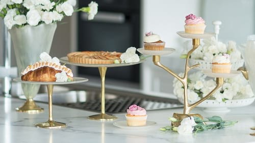 Tall pedestal cake stands and cake plates for high tea by Anna Vasily.