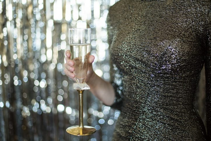 Gold champagne flutes to toast at your NYE party.