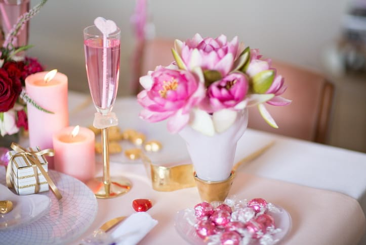 Galentine's Day Ideas - Organize a Galentine's Day brunch for your friends! Go for a pink table setting with floral arrangements in stunning decorative glass vases. Don't forget to get lots of chocolate!