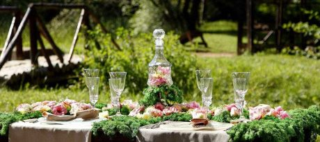 A floral tablescape with lots of greenery and elegant floral decorative plates by AnnaVasily.