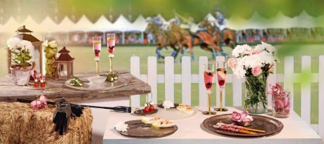 Luxury table setting with glass serving platters for the Portsea Polo.